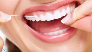 فواید استفاده از نخ دندان چیست؟ و چرا باید از نخ دندان استفاده کنیم؟